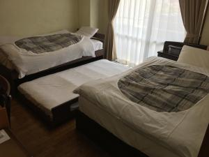 A bed or beds in a room at Hostel Mallika
