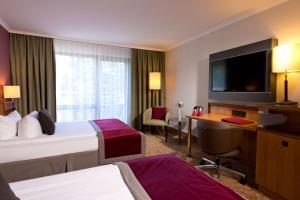 Ein Bett oder Betten in einem Zimmer der Unterkunft Leonardo Royal Hotel Baden- Baden