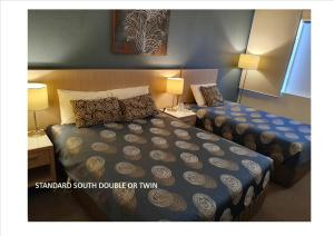 A bed or beds in a room at Quality Hotel Sherbourne Terrace
