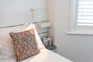 A bed or beds in a room at Blueshutters
