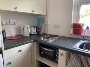 A kitchen or kitchenette at Tig Lammax