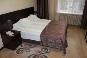Кровать или кровати в номере Oka Hotel