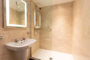 A bathroom at Barton Manor Hotel & Spa; BW Signature Collection
