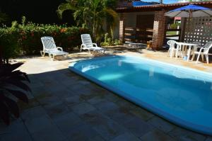 A piscina localizada em Pousada Lua Azul ou nos arredores