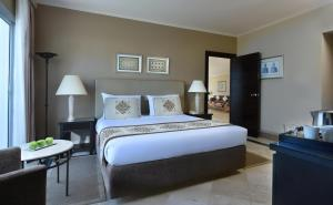 A bed or beds in a room at Jaz Fanara Resort