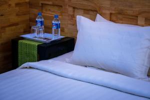 Un ou plusieurs lits dans un hébergement de l'établissement Ever New Guest House
