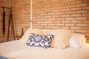 A bed or beds in a room at Solar Maria Carolina