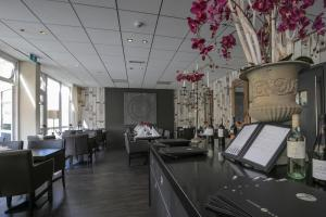Een restaurant of ander eetgelegenheid bij Fletcher Hotel Restaurant Zeeduin