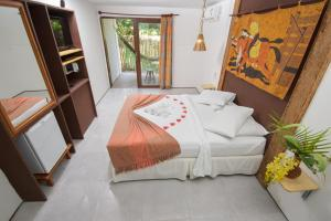 A bed or beds in a room at Pousada Barra Velha