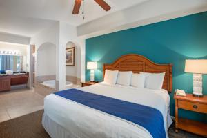 A bed or beds in a room at Lake Buena Vista Resort Village and Spa, a staySky Hotel & Resort Near Disney
