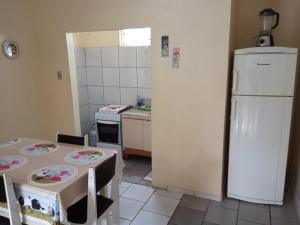 A kitchen or kitchenette at Pousada Estrela do Mar