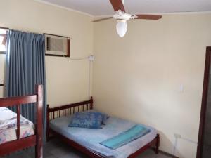 A bed or beds in a room at Pousada Estrela do Mar