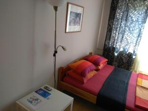 A bed or beds in a room at Apartment Stepana Bandery Street