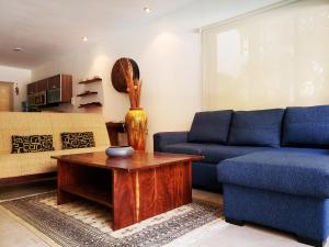 A seating area at Private pool Access 2BR condo in the best location in Tulum by Happy Address