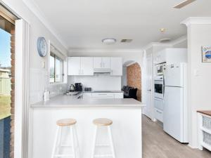 A kitchen or kitchenette at Beach Paradise @ Anna Bay