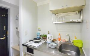 KIYAZA City Sapporoにあるキッチンまたは簡易キッチン