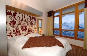 A bed or beds in a room at Résidence Prestige Odalys Edenarc