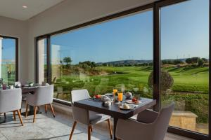 A restaurant or other place to eat at Aphrodite Hills Golf & Spa Resort Residences - Junior Villas