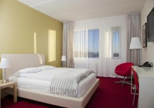 A bed or beds in a room at Airport Hotel Aurora Star