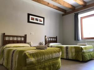A bed or beds in a room at Albergue Orion