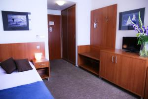 A television and/or entertainment center at Academic Hotel & Congress Centre