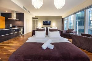Кровать или кровати в номере Rockmond 61 Lux