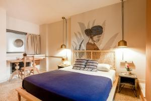 A bed or beds in a room at Selina Cartagena