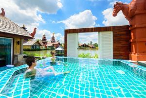 The swimming pool at or near Ammata Lanta Resort