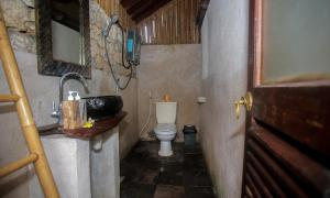 A bathroom at Balangan Sea View Bungalow