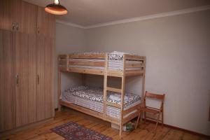 A bunk bed or bunk beds in a room at Hooga Guest House