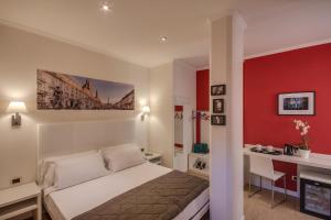 A bed or beds in a room at Tritone Top House