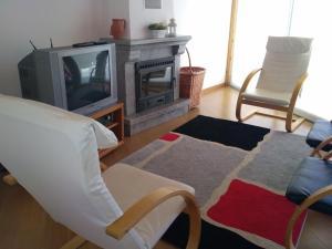 A seating area at Casa do Outeiro