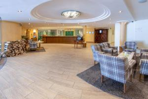 The lobby or reception area at Hotel & Spa Silberhorn Wengen