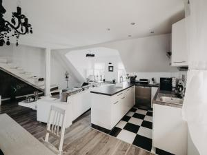A kitchen or kitchenette at Apartament Rynek Pniewy