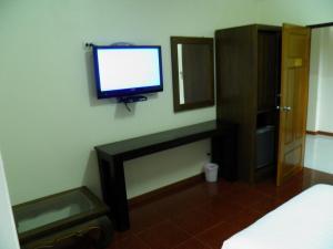 A television and/or entertainment center at Ruen Narisra Resort