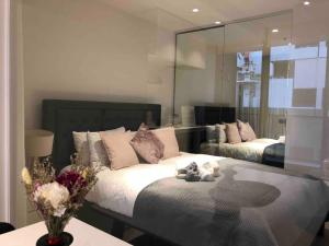 A bed or beds in a room at South Yarra Claremont Apartment