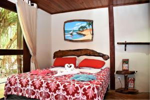 A bed or beds in a room at Pousada Kite Cabana
