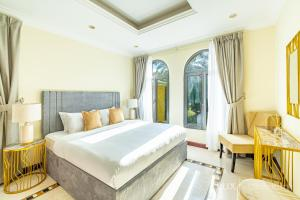 A bed or beds in a room at LUX - The Ocean Pearl Villa