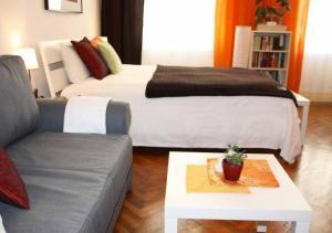 Postel nebo postele na pokoji v ubytování Cosy Appartement close to City