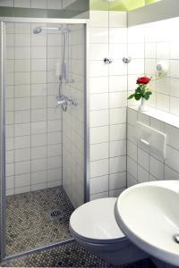 Ein Badezimmer in der Unterkunft Christkönigshaus