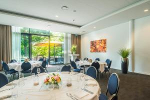 Een restaurant of ander eetgelegenheid bij Fletcher Hotel-Restaurant de Wageningsche Berg