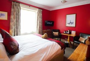 A bed or beds in a room at Feversham Arms Hotel & Verbena Spa