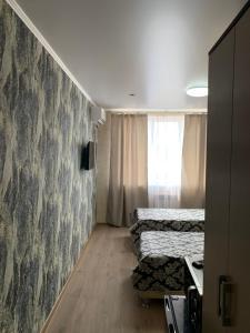 Кровать или кровати в номере Mini Hotel Uyut
