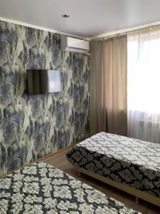 Телевизор и/или развлекательный центр в Mini Hotel Uyut