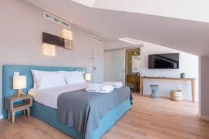 A bed or beds in a room at Reserva FLH Hotels Ericeira