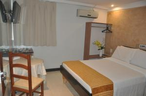 A bed or beds in a room at Hotel Sempre Ogunja