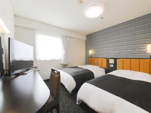 Un ou plusieurs lits dans un hébergement de l'établissement APA Hotel Yamagata Tsuruoka Ekimae