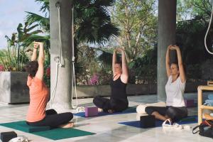 The fitness center and/or fitness facilities at Adila Bali