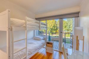 A bunk bed or bunk beds in a room at Mimosa Holiday House