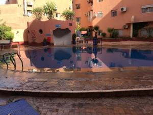 The swimming pool at or near Appart H36
